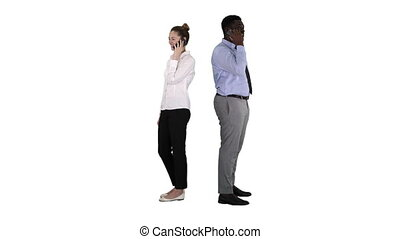 Young African American man and woman standing back to back...