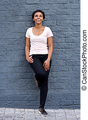 Full length young african American woman smiling