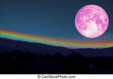 full milk blood moon silhouette hill and rainbow on night sky