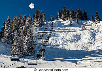 Full Moon above Riding Chairlift in French Alps Mountains, Megeve