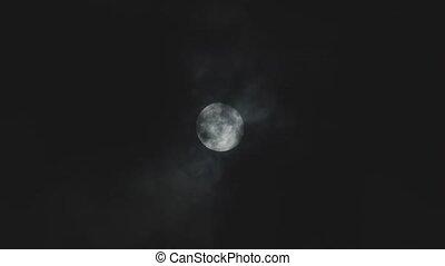 Full moon against cloudy night sky