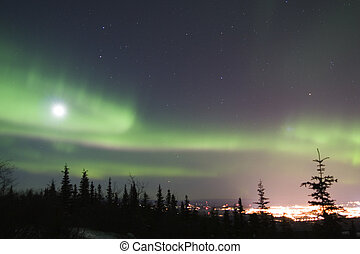 Active duo-color northern lights and bright full moon over Fairbanks, Alaska