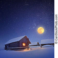 Full moon and hut - Winter landscape with a starry sky and...