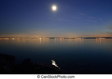 full moon and stars over Bodensee, germany
