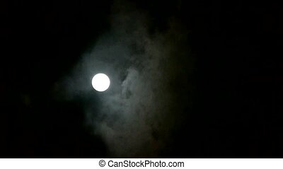Full moon at cloudy sky,night flight over clouds,mystery...