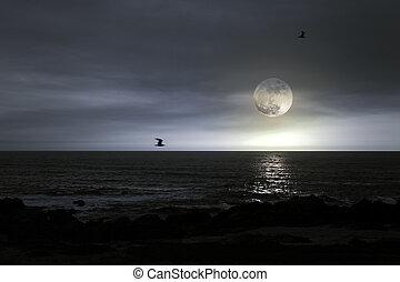 Full moon beach - Moody full moon rise over Atlantic ocean
