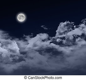 Full moon by night - glowing full moon at night with...