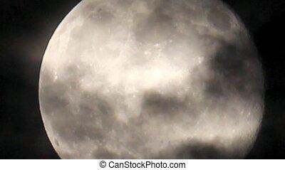 full moon detail behind clouds