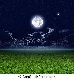 Full moon, green field