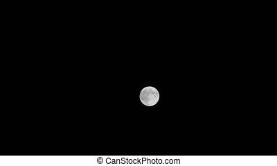 Full Moon in Black Sky - Isolated full moon against a pitch...