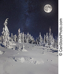 Full moon in night sky in the winter mountains