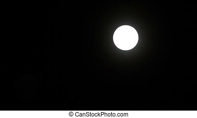 Full moon in the black sky.