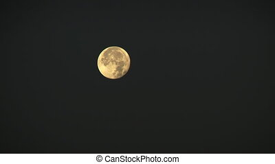 Full moon in the night sky an arc. A full moon is the lunar...