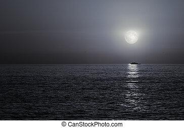 Full moon in the sea - Trawler sailing on full moon night...
