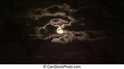 full moon in the sky with clouds