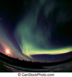 Full Moon meets Aurora Borealis - Aurora Borealis can be...
