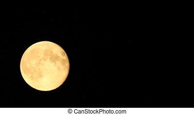 full moon moves across the sky in t