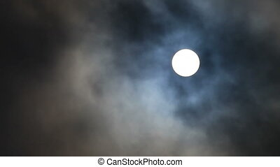 Full moon moving in and out clouds in realtime