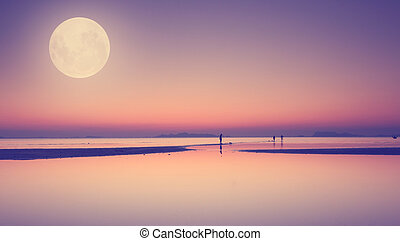 Full moon over blue sea and sky ,Long exposure technique with vintage filter