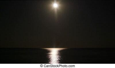full moon over sea