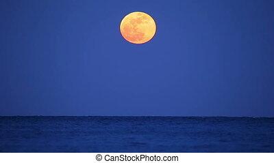Full moon over the ocean in Spain