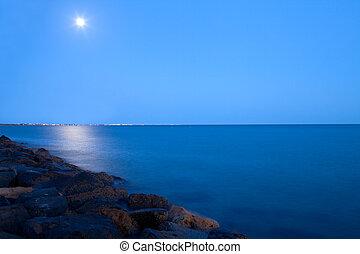 Full Moon Over The Sea - Full moon over the sea at night,...