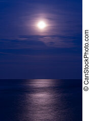 Full moon over the sea, vertical shot