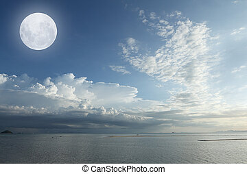Full moon over tropical sea and white cloud