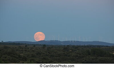 Full moon over windmills