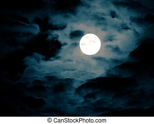 Full Moon - Photograph of the moon on a cloudy night