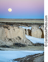 Full moon rise over prairie