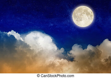 Full moon rising above glowing clouds in night sky