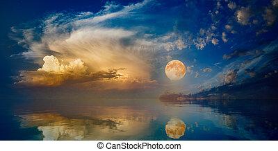 Full moon rising above serene sea in sunset sky