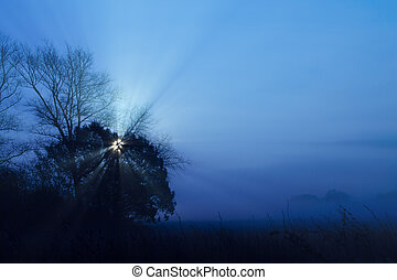 Full moon rising with blue mist