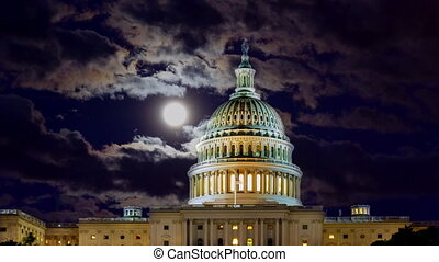 Full moon shining on the night sky with U.S. Capitol ...