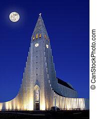 Full moon shining over Hallgrimskirkja in Reykjavik
