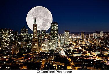 Full Moon - A full moon over a urban metropolis