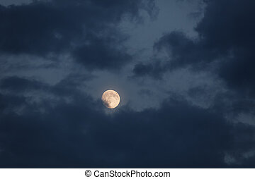 Full moon with dark cloud