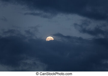 Full moon with dark cloud