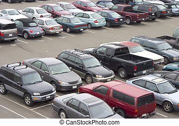 Full Parking Lot - A parking lot crammed with cars. All...