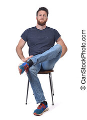 full portrait of a man sitting on a chair legs crossed on white background
