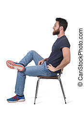 full portrait of a man sitting on a chair on white