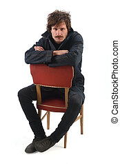 full portrait of a man sitting on a chair
