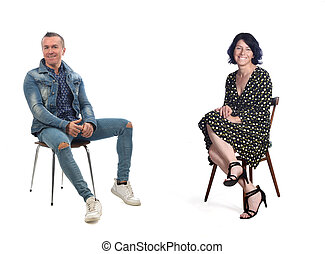 full portrait of a sitting couple on white