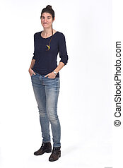 full portrait of a woman with hands on pockets on white background