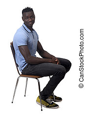 full portrait of african man sitting a chair on white background