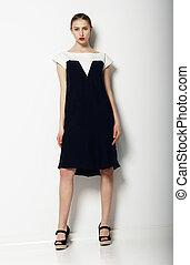 Full Portrait of Elegant Refined Female in Urban Black - White  Dress. Fashion