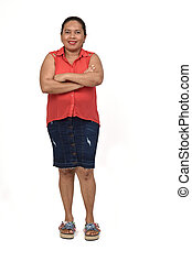full portrait of latin woman on white background, arms crossed
