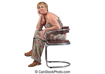 full portrait of middle aged woman sitting on a chair on white