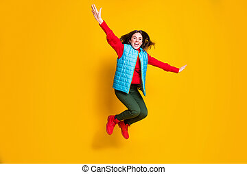 Full size photo of excited girl jump imagine fly plane feel carefree careless wear red sweater boots isolated over bright shine color background